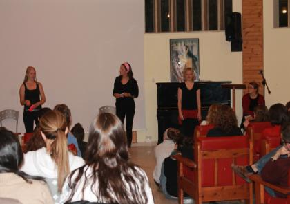 (from left) Charlotte Mikat-Stevens, Chloe Verhoef (both LUC), and Samantha Moyer (SLU) performing the opening act.jpg