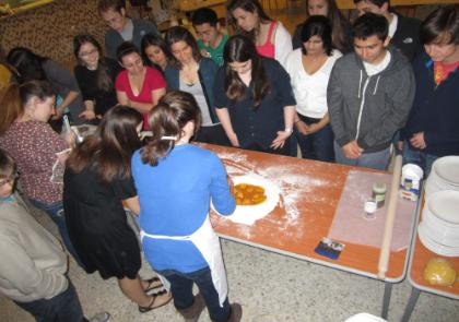 (from left) Students Laura Mikeworth (MU) and Anna Springer (LUC) making pasta.JPG